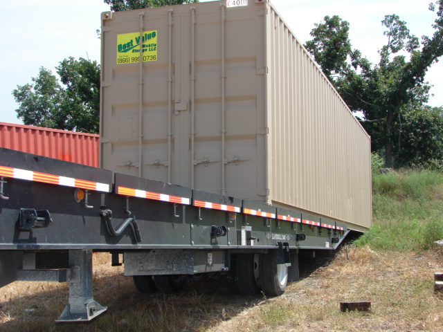 A Best Value Mobile Storage delivery truck unloading a container